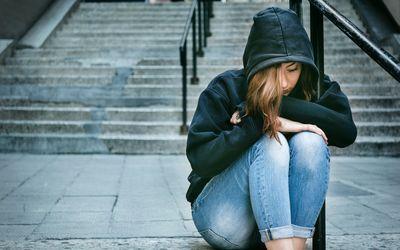 Teen sitting on steps alone