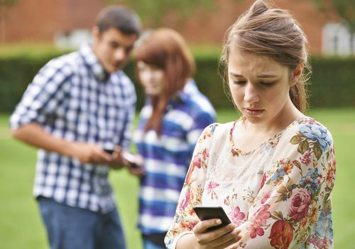 teen checking smartphone