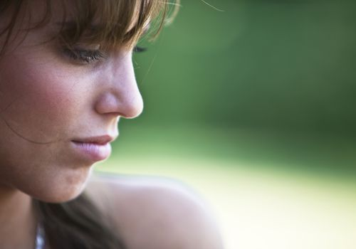 a young woman looking sad