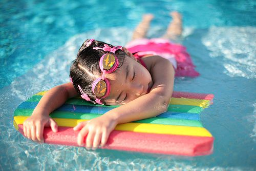 child sleeping in pool
