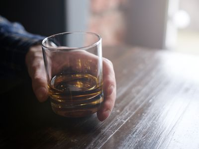 Man holding glass of whisky