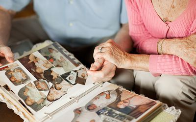 Older couple looking through photo albums