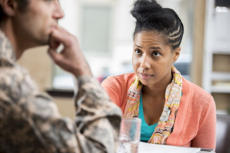 Concerned female counselor talks with veteran