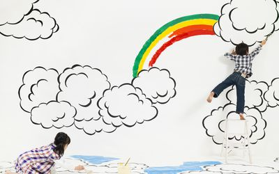 Creative children drawing on wall