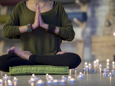 Woman sitting on meditation cushion