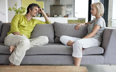 Couple having conversation in living room