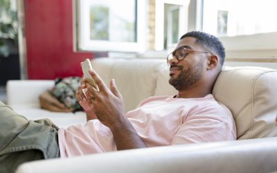 Man texting family on his phone