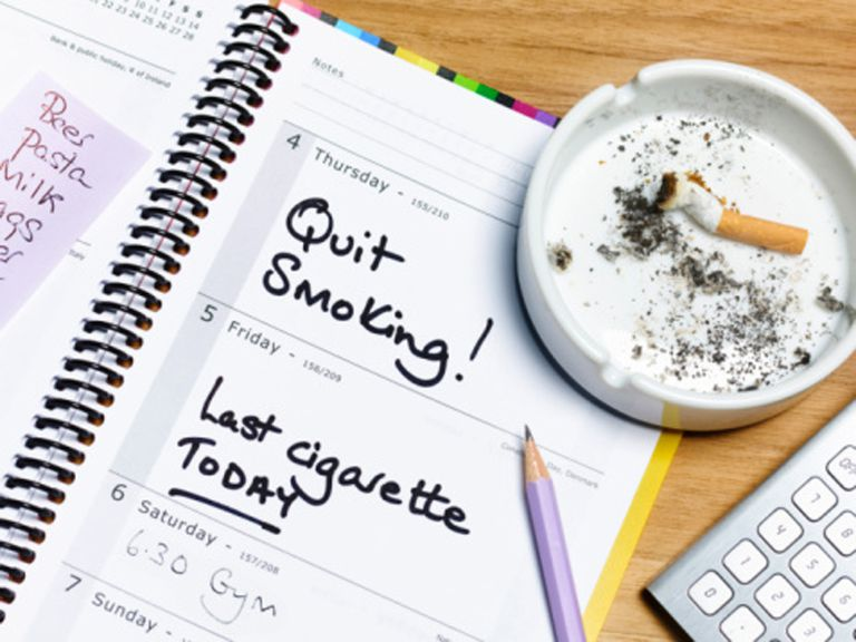 Planner with quit smoking written in it