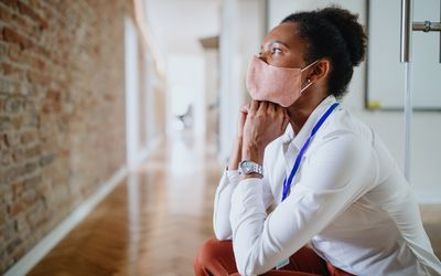 business woman wearing mask looking stressed