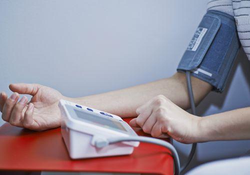 person testing blood pressure