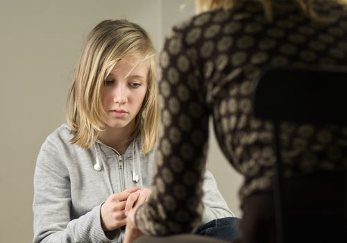 A depressed teen in a counseling session.