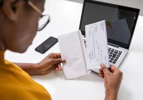 Woman opening a paycheck