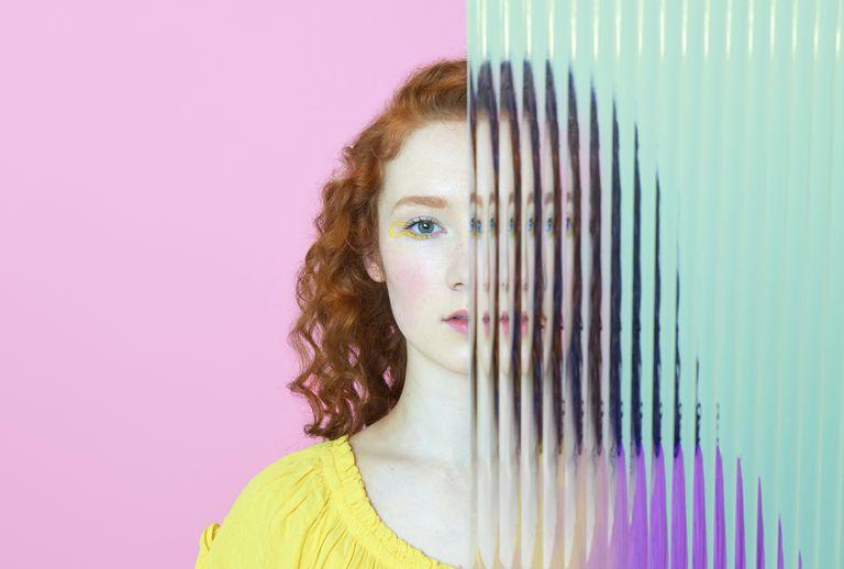 Girl behind plastic wall.