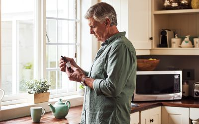 Man looking at bottle of CBD oil