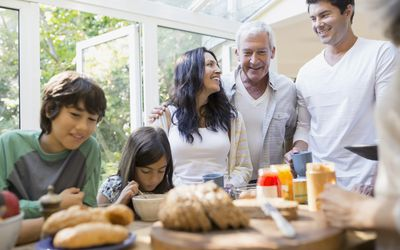 Multi-generation family eating in kitchen