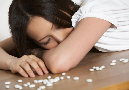 Woman seeming to overdose on sedatives