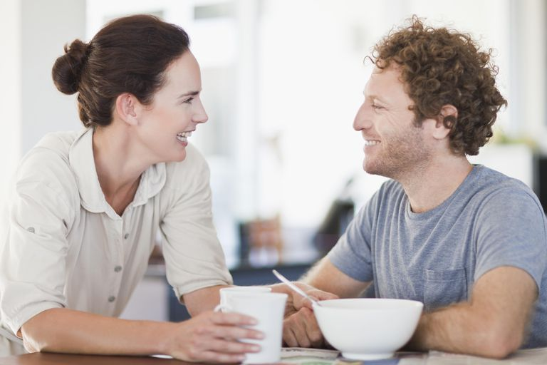 Couple talking at breakfast