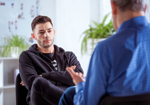 Man listening to therapist