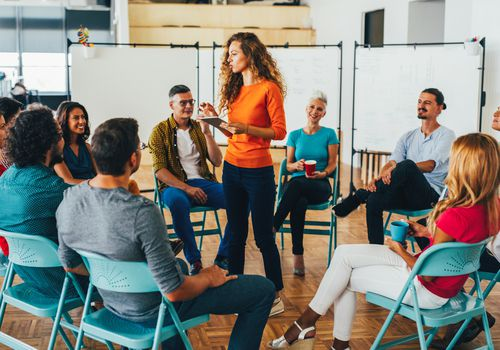 People in a circle in a meeting
