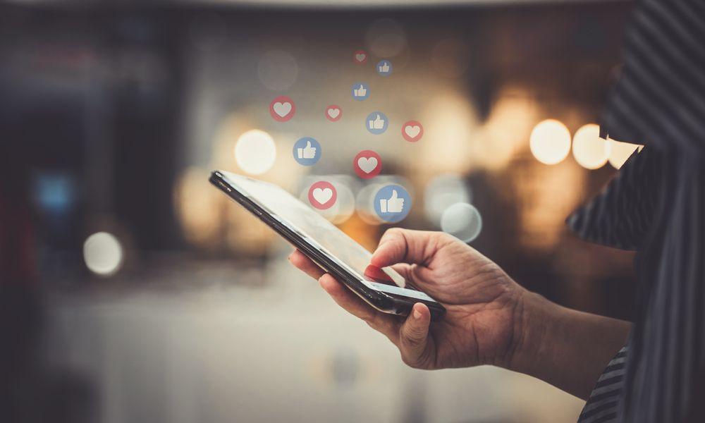 hand of person using social media