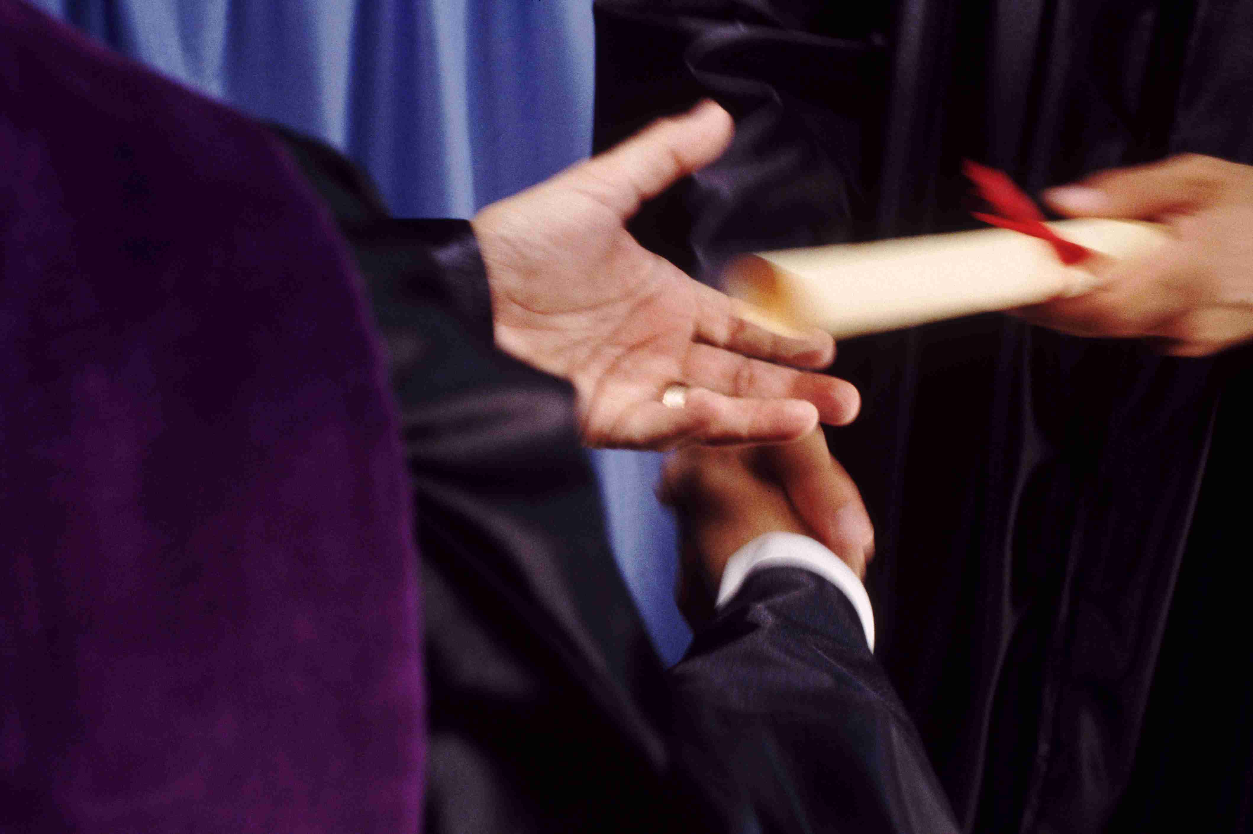 A hand shake and a diploma