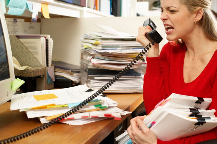 Woman Screaming Into Telephone