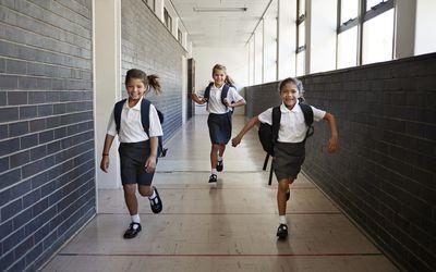 Girls leaving school on last day for summer break.