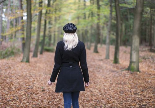 Woman walking alone in the forest