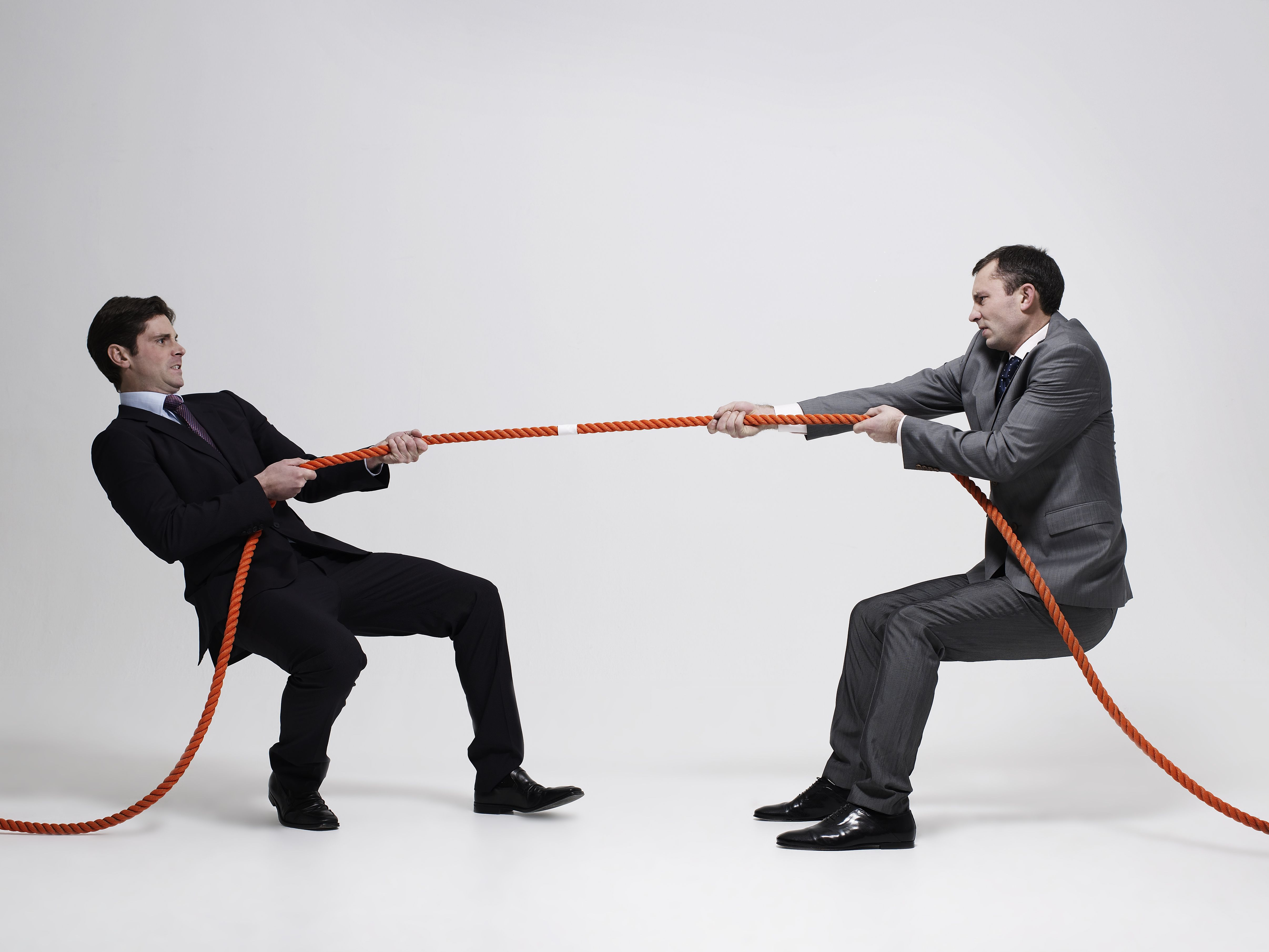 Tug-of-war in suits