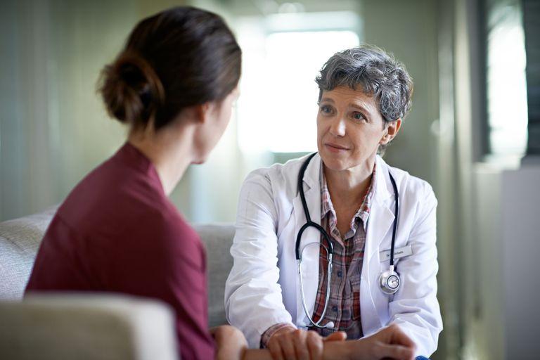 Doctor calming patient