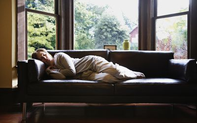 Woman asleep on couch