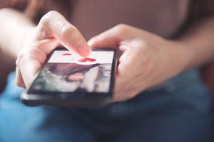 female hands on online dating app