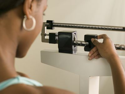 BIPOC person weighing on scale