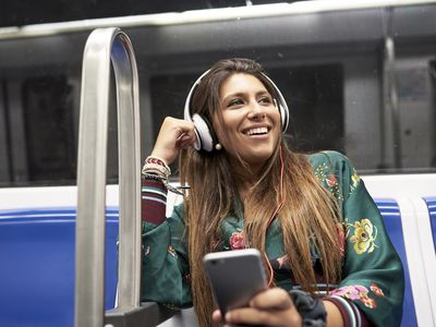 Woman listening to podcast on the train