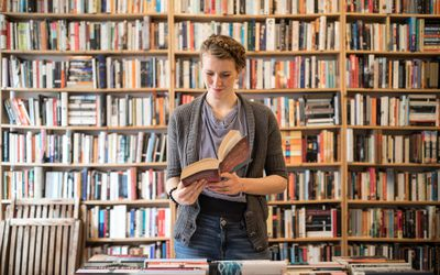 woman reading in a bookstore