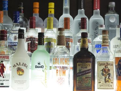 rows of bottled rum, gin and vodka