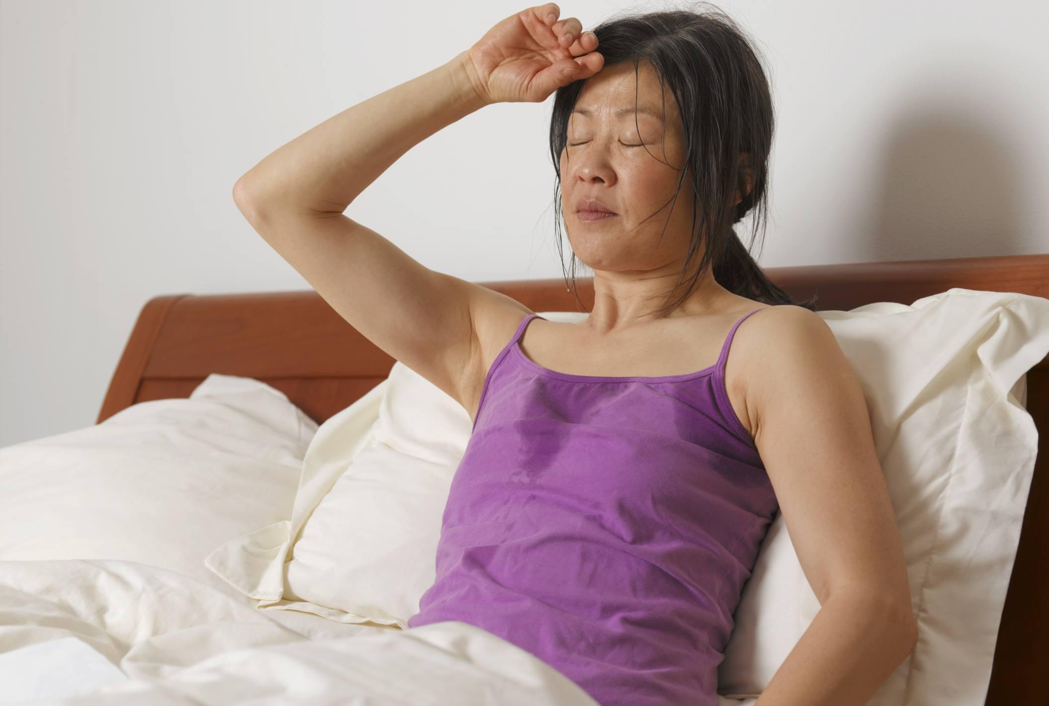 sweaty woman in bed