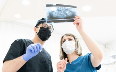 Two doctors male and female discussing x-ray medical case