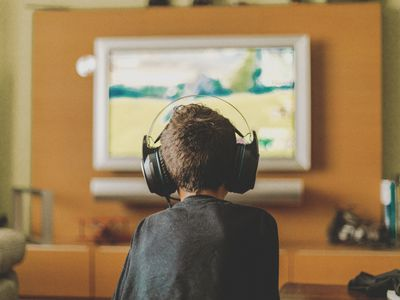 boy enjoying video game console at home
