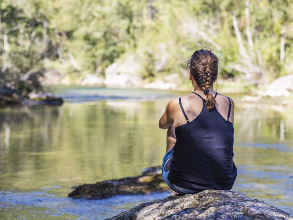 Middle aged woman looking at a river