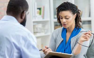 Therapist reviews patient's case