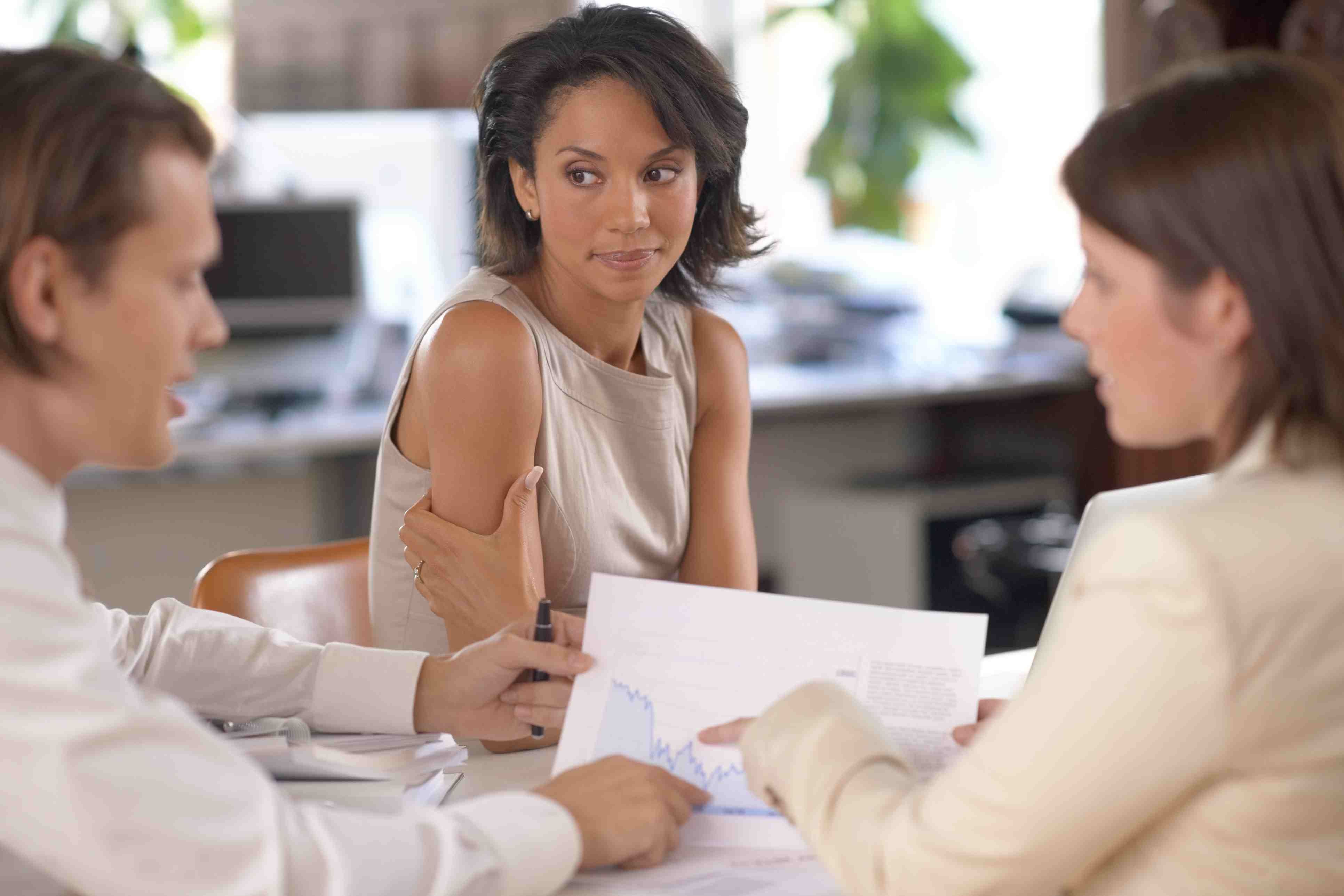Woman not talking in a business meeting