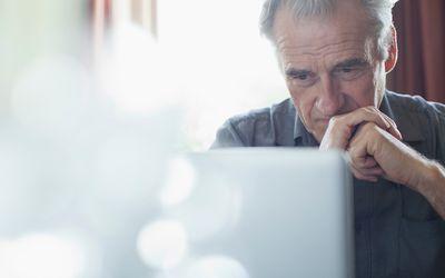 old man looking at a computer