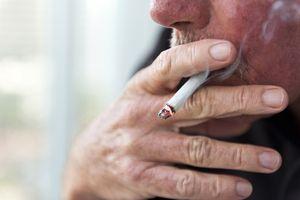 Close up of a man smoking a cigarette