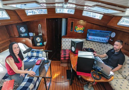 Amy Morin and Nick Valentin record The Verywell Mind Podcast from a sailboat in the Florida Keys