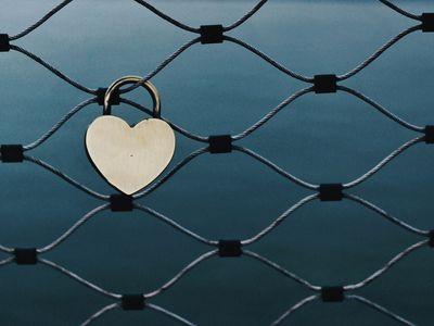 Heart shaped lock on a fence