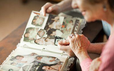 People looking through photo album