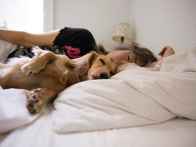 Woman laying with her dog.