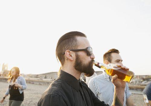 Man drinking bottle of beer