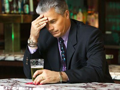 Downcast businessman in bar